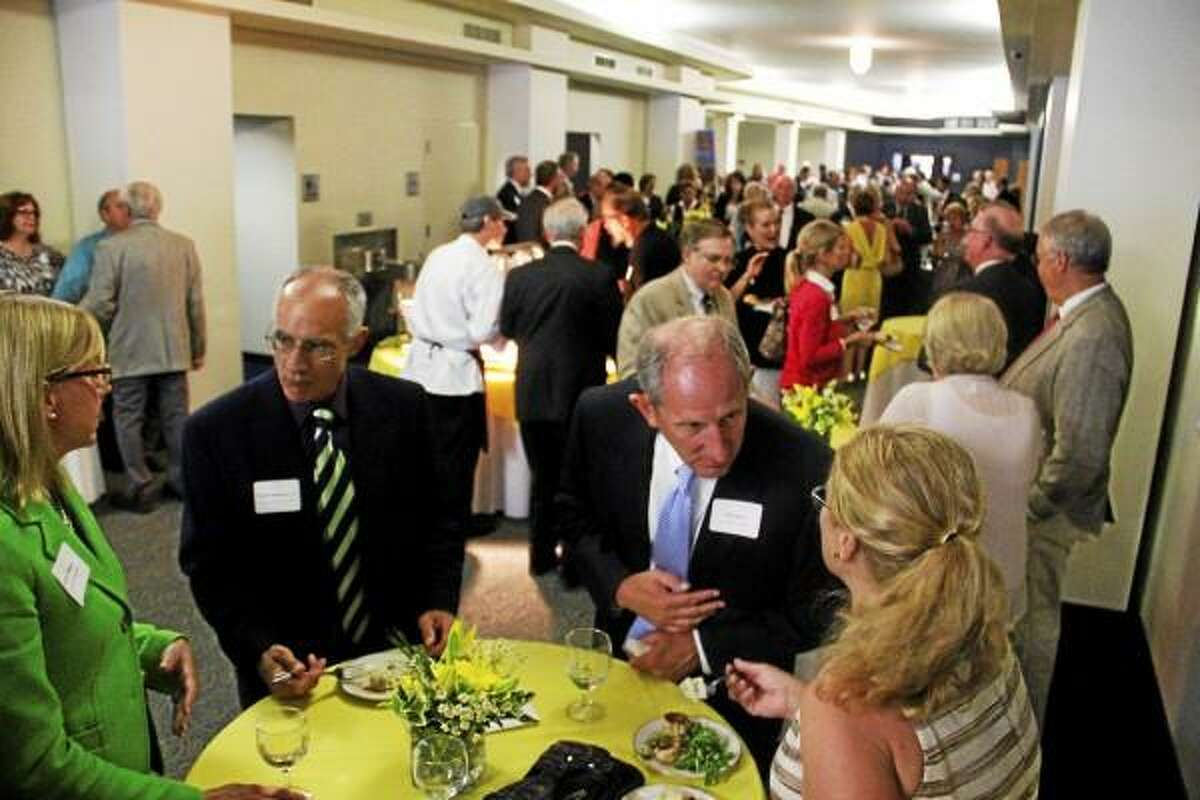 Guests dine and mingle during the Northwest Connecticut's Chamber Celebration of Success dinner on Thursday, June 27, outside the lobby of the Nancy Marine Studio Theater. The business organization honored two community members and one community center during the dinner. (Esteban L. Hernandez Register Citizen)
