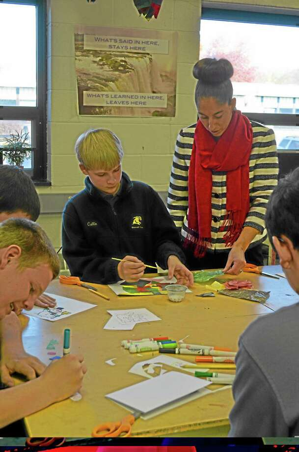 Morgan Slkovich-For the Register CitizenCollin Schultz, 14, freshman leadership student gets feedback on his holiday card from Assistant Principal Tanya Celadon. Photo: Journal Register Co.