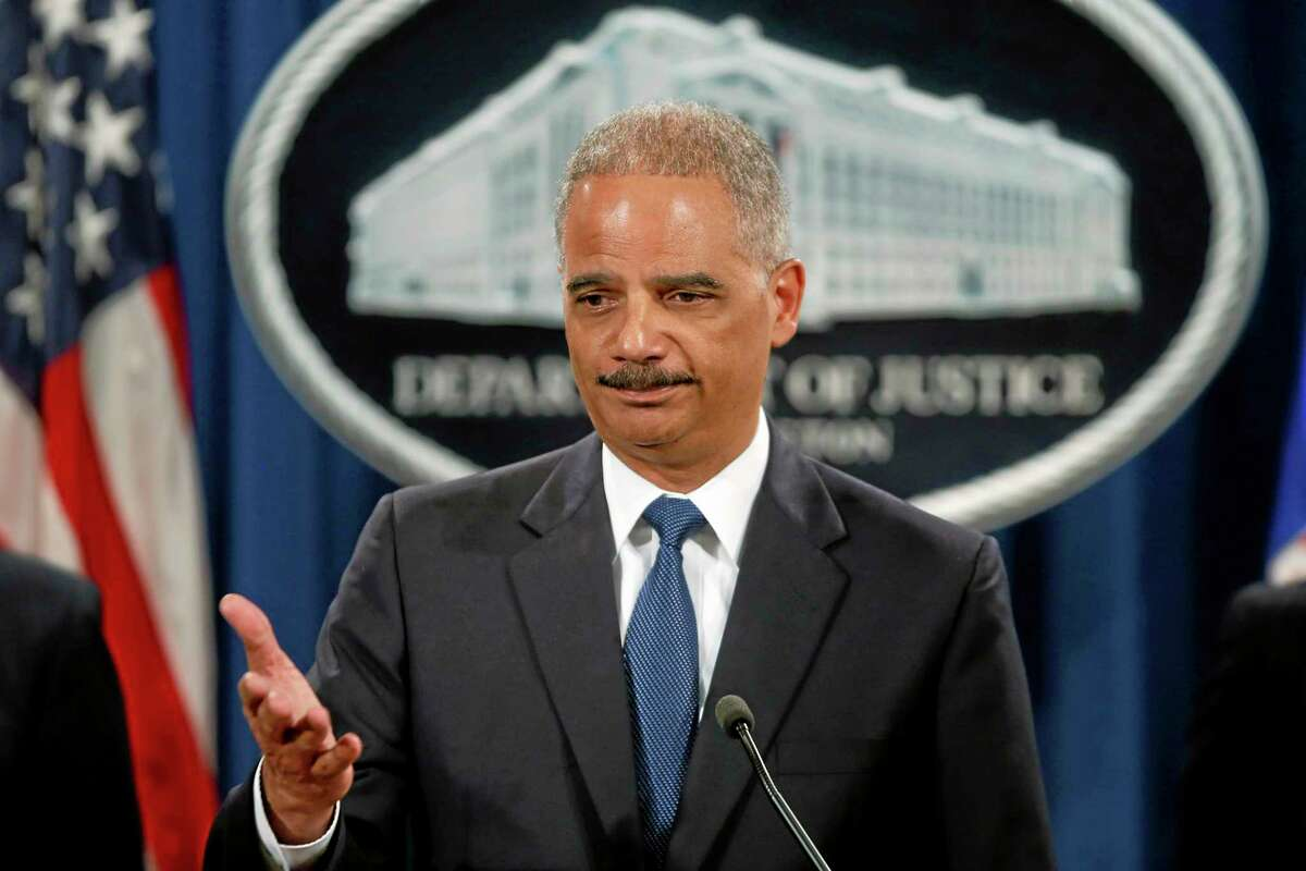 FILE - This May 19, 2014 file photo shows Attorney General Eric Holder taking questions during a news conference at the Justice Department in Washington where he announced that a U.S. grand jury has charged five Chinese hackers with economic espionage and trade secret theft. In a 31-count indictment, the Justice Department said five Chinese military officials operating under hacker aliases such as ìUgly Gorilla,î