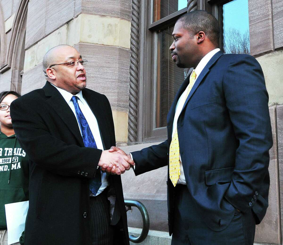 (Peter Casolino ó New Haven Register) Gary Holder-Windfield, right, gets a handshake from Darnell Goldson, after Goldson removed himself from the 10th district senate race in Connecticut. The two met outside New Haven City hall. Holder-Windfield is seeking the senate seat, formerly held by Toni Harp. pcasolino@NewHavenRegister