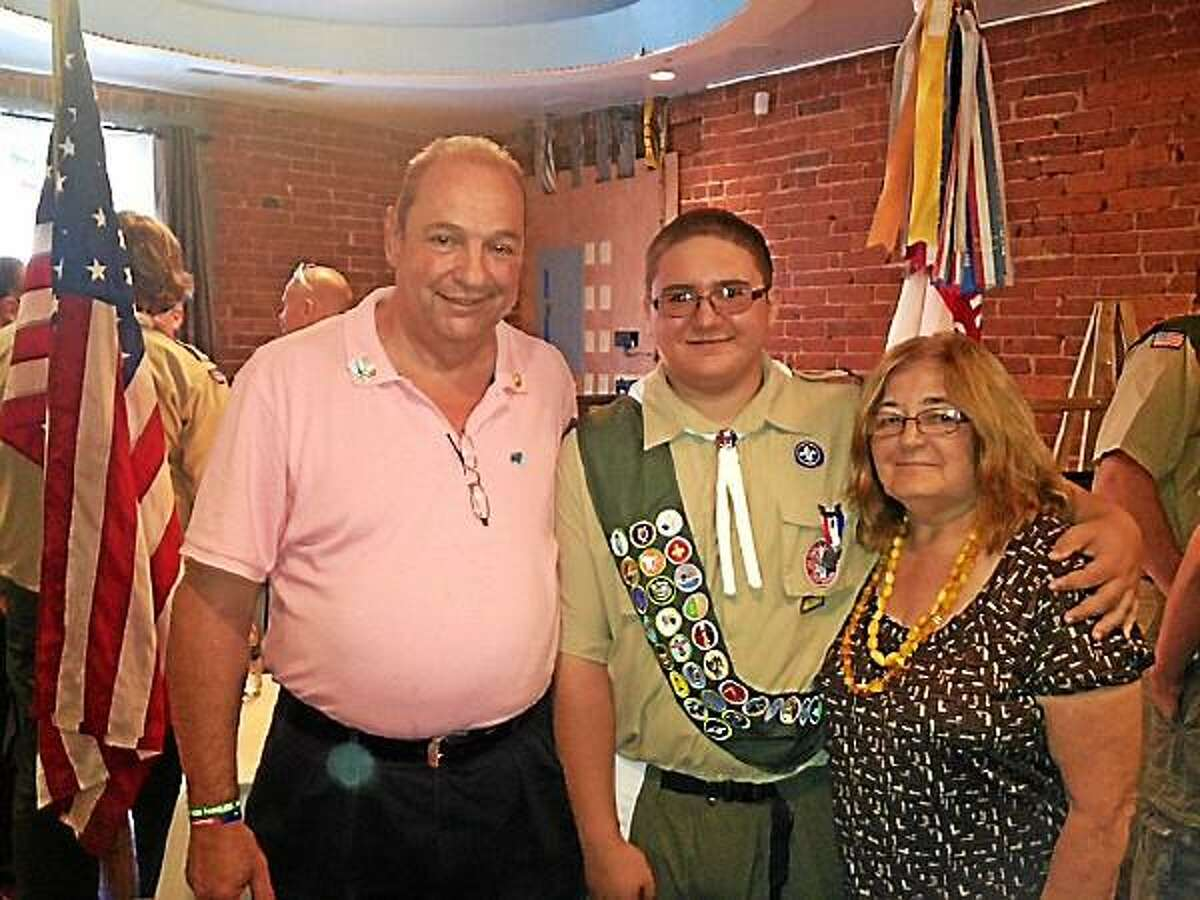 Submitted photo - Eagle Scout Brandon Herman, center, with his grandparents, Rick and Cecilia Dalla Valle of Torrington.