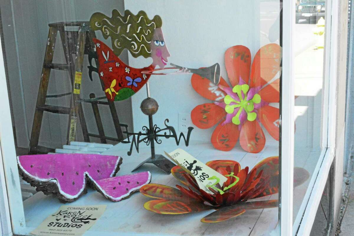 Some of Rossi's art on display in the window of her new studio at 27 East Main Street.