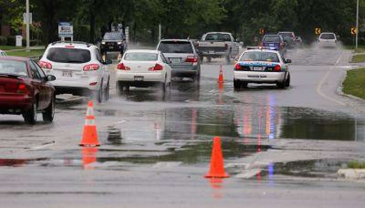 Flooding along Arlington Heights Road and Dundee Road in Buffalo Grove, Ill caused major traffic problems on Wednesday June 26, 2013.