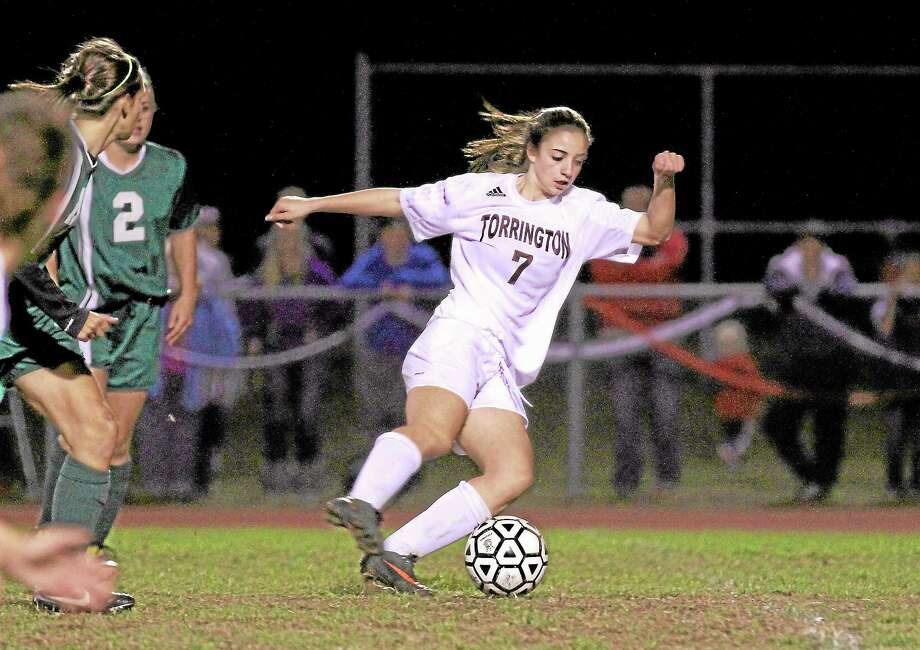Marianne Killackey — Special to Register Citizen Torrington's Taylor Pestritto attemps to advance the ball in a game earlier this season. Photo: Journal Register Co. / 2013