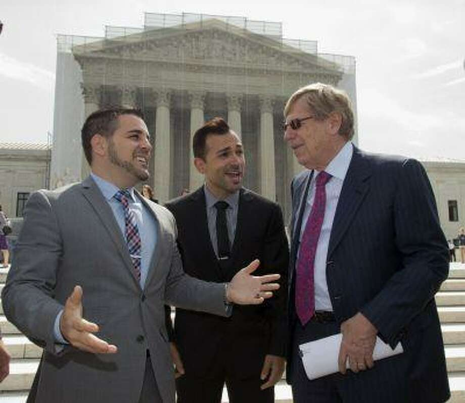 Ted Olson, right, attorney for the Proposition 8 plaintiffs, Jeff Zarrillo, left, and Paul Katami, center, talk outside the Supreme Court in Washington, Thursday, June 20, 2013, as they leave after a decision in their case on gay marriage, Hollingsworth v. Perry, was not announced today. With only a few days remaining in the court's term, several major cases are still outstanding that could have widespread political impact on same-sex marriage, voting rights, and affirmative action. (AP Photo/J. Scott Applewhite) Photo: AP / AP