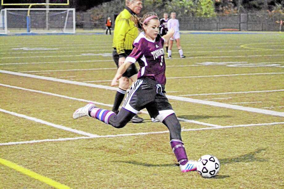 Torrington's Olivia Morrison kicks a free kick during Torrington's 2-1 loss to Watertown. Photo: Pete Paguaga — Register Citizen