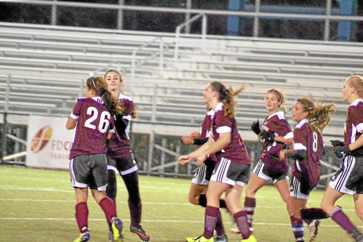 Torrington's Alexis Tyrrell celebrates with teammates after scoring her tying goal in the Red Raiders 2-1 loss to Watertown.