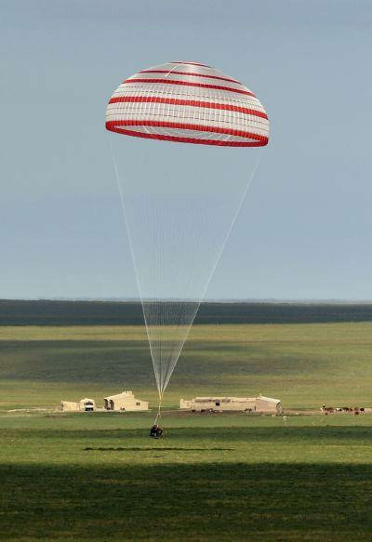 The re-entry capsule of China's Shenzhou-10 spacecraft lands at its main landing site in north China's Inner Mongolia Autonomous Region, June 26, 2013.