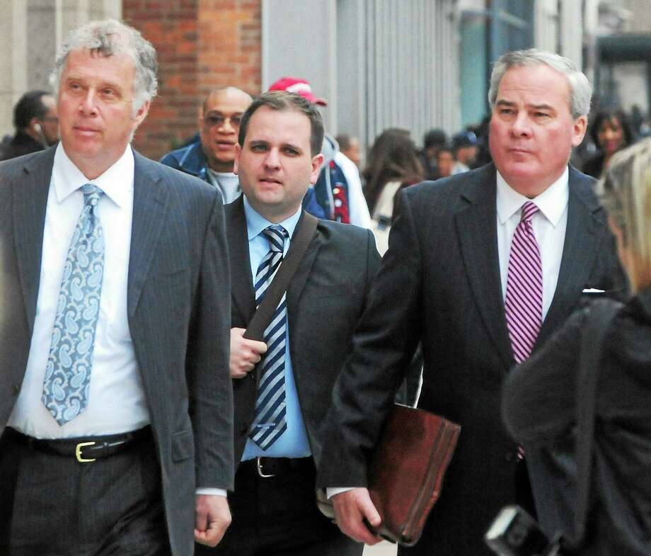 Former Connecticut Governor John G. Rowland, right,  arrives with his attorney Reid Weingarten, far left, at the Federal Courthouse in New Haven Friday afternoon, April 11, 2014 to face a seven-count indictment a campaign fraud investigation in Connecticut's 5th Congressional District. Photo: (Peter Hvizdak - New Haven Register)  / ©Peter Hvizdak /  New Haven Register