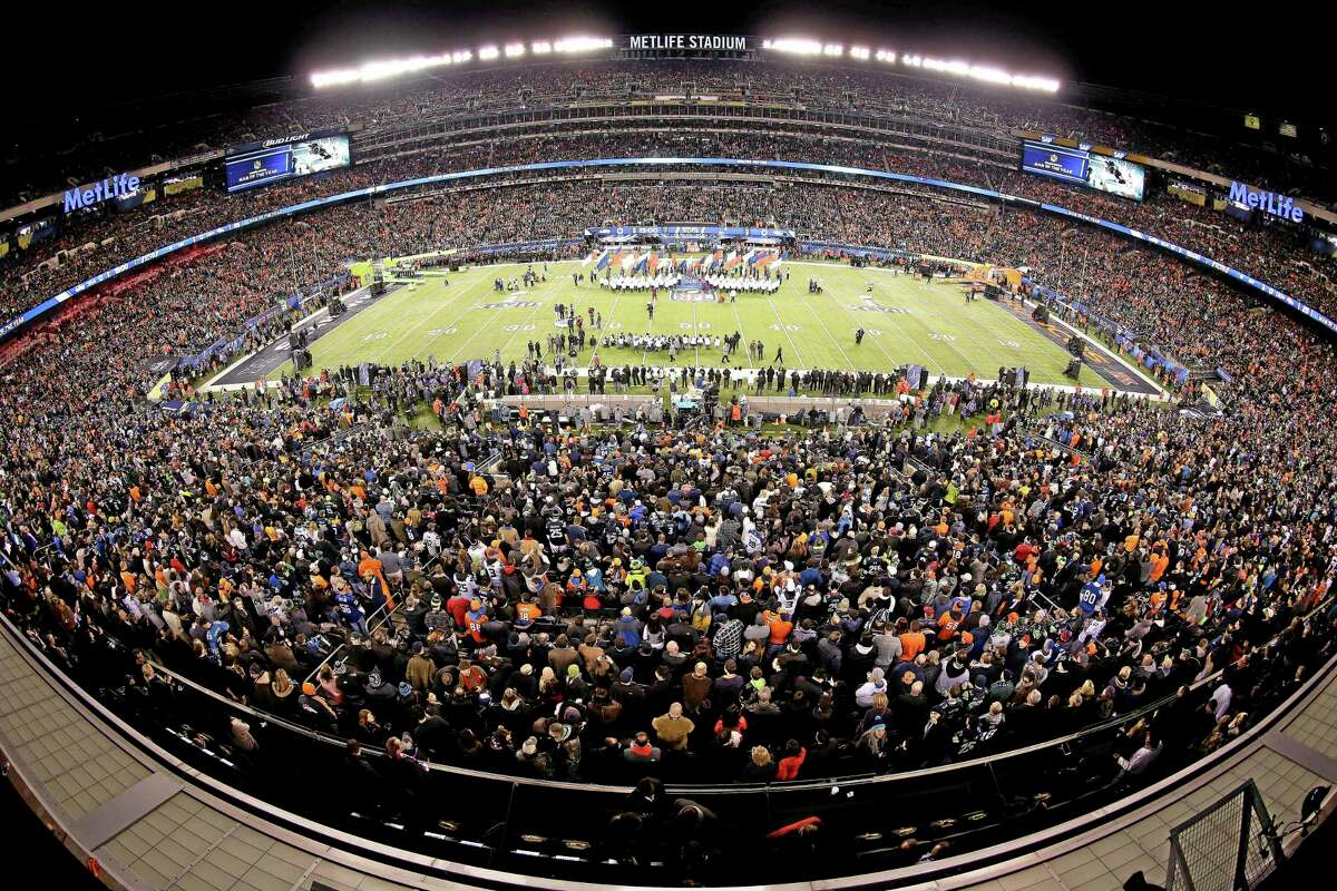 This image made with a fisheye lens shows pregame activity before Super Bowl XLVIII on Feb. 2 in East Rutherford, N.J.