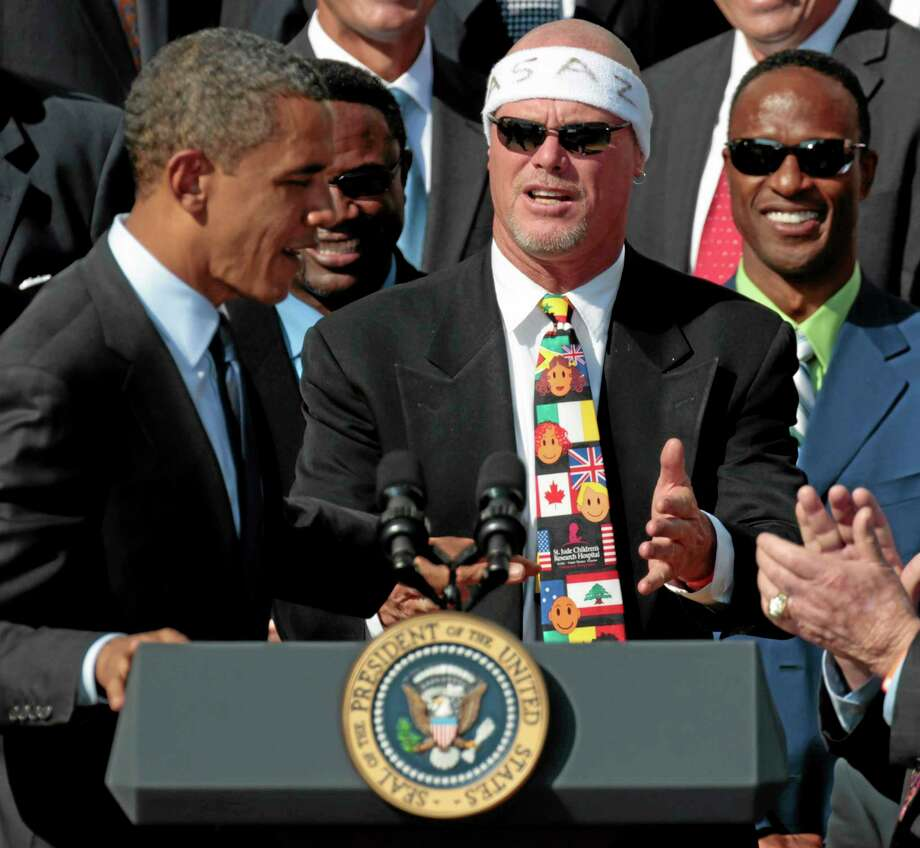 In this Oct. 7, 2011, file photo, President Barack Obama looks toward quarterback Jim McMahon as he honors the Super Bowl XX champion Chicago Bears during a ceremony on the South Lawn of the White House in Washington. A group of retired NFL players says in a lawsuit that the league illegally supplied them with risky painkillers that numbed their injuries and led to medical complications. Attorney Steven Silverman says his firm filed the lawsuit Tuesday in federal court in San Francisco. The eight named plaintiffs include McMahon and former teammate and Hall of Fame defensive end Richard Dent. Photo: Pablo Martinez Monsivais — The Associated Press  / AP