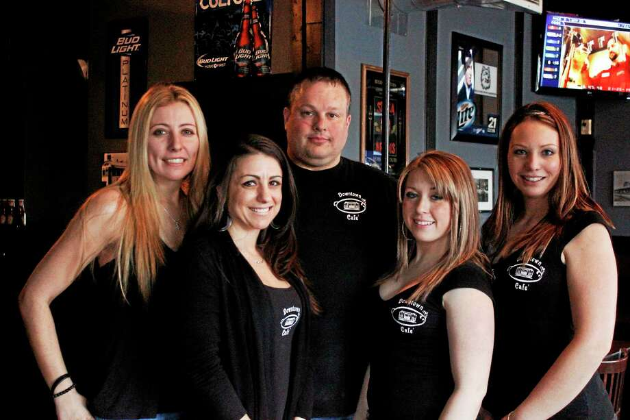 Owner Paul Murdock, middle, and his staff in Downtown Cafe. Photo: Shako Liu — Register Citizen