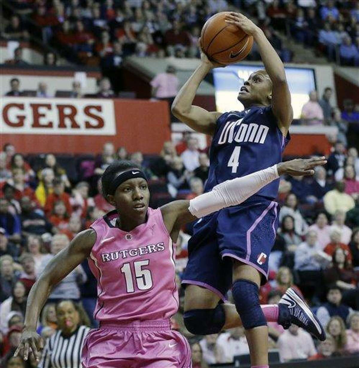 Connecticut's Moriah Jefferson (4) takes a shot over Rutgers' Syessence Davis (15) during the first half of an NCAA college basketball game Saturday, Feb. 16, 2013, in Piscataway, N.J. (AP Photo/Mel Evans)
