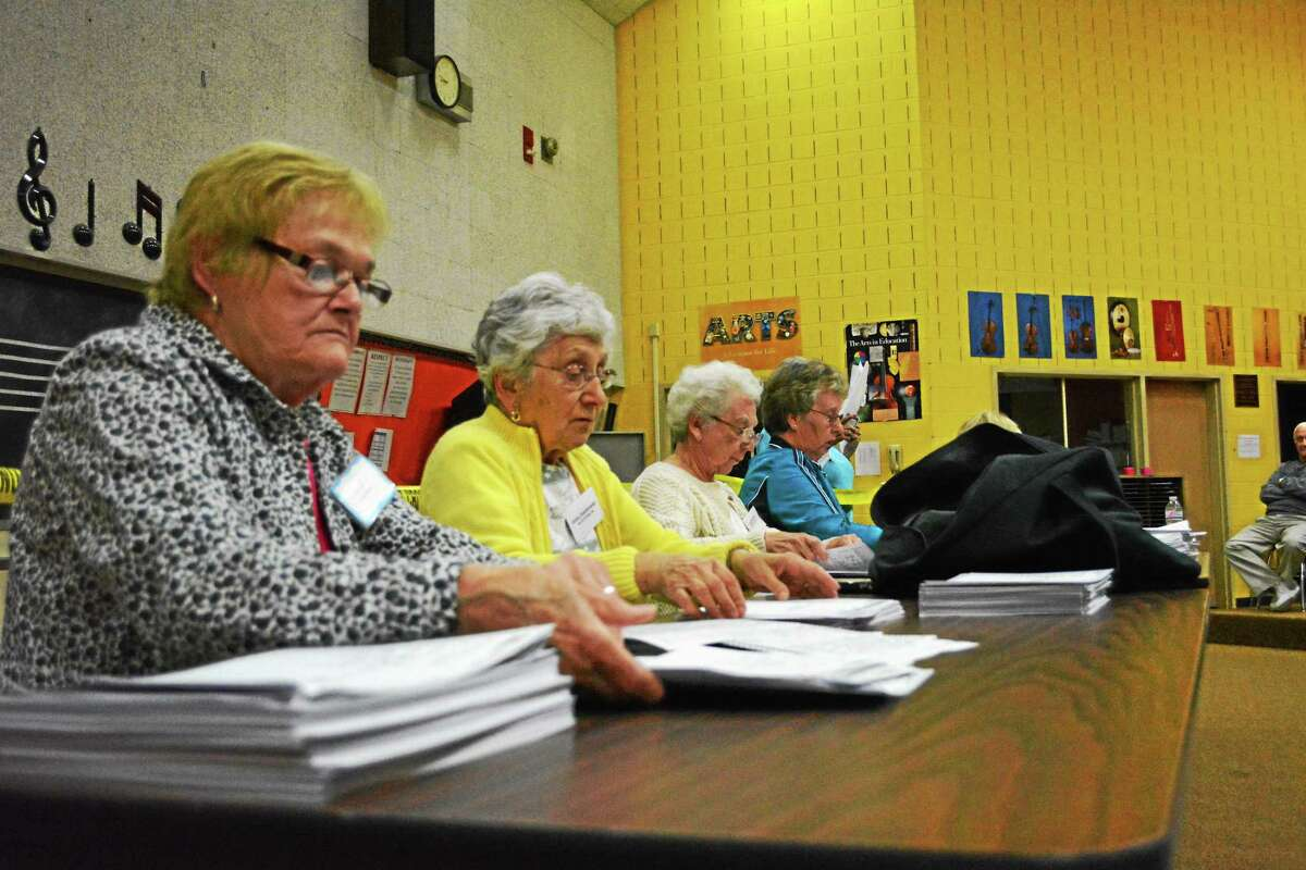 Dawn Quigley, Lucy Bascetta, Sally Mangione and others tally the votes in Winsted's Board of Selectmen recount.