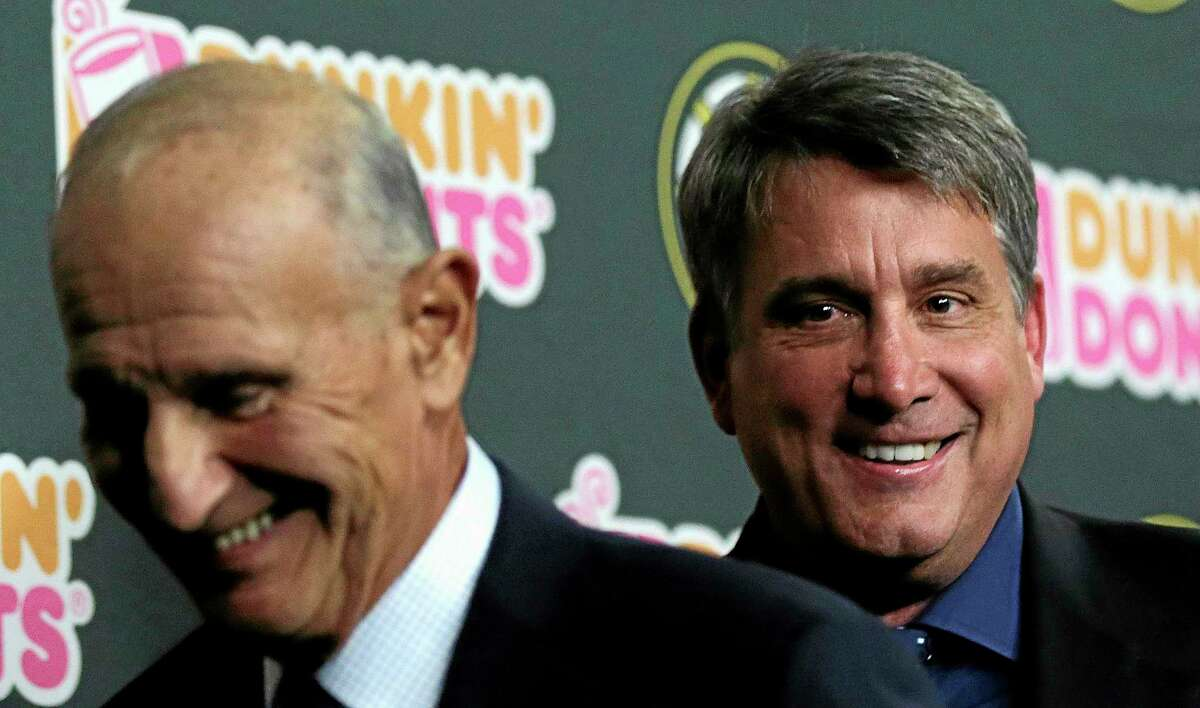 Boston Bruins president Cam Neely, right, smiles as he leaves with team owner Jeremy Jacobs after a news conference in Boston on Tuesday.