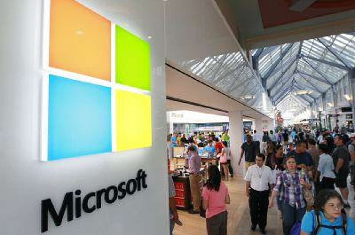 In this Thursday, Aug. 23, 2012 file photo, the Microsoft Corp. logo, left, is seen on an exterior wall of a new Microsoft store inside the Prudential Center mall, in Boston. Microsoft will use its annual developers conference to release a preview of Windows 8.1, a free update that promises to address some of the gripes people have with the latest version of the company's flagship operating system. The Build conference, which starts Wednesday, June 26, 2013, in San Francisco, will give Microsoft's partners and other technology developers a chance to try out the new system before it becomes available to the general public later in the year. (AP Photo/Steven Senne, File)