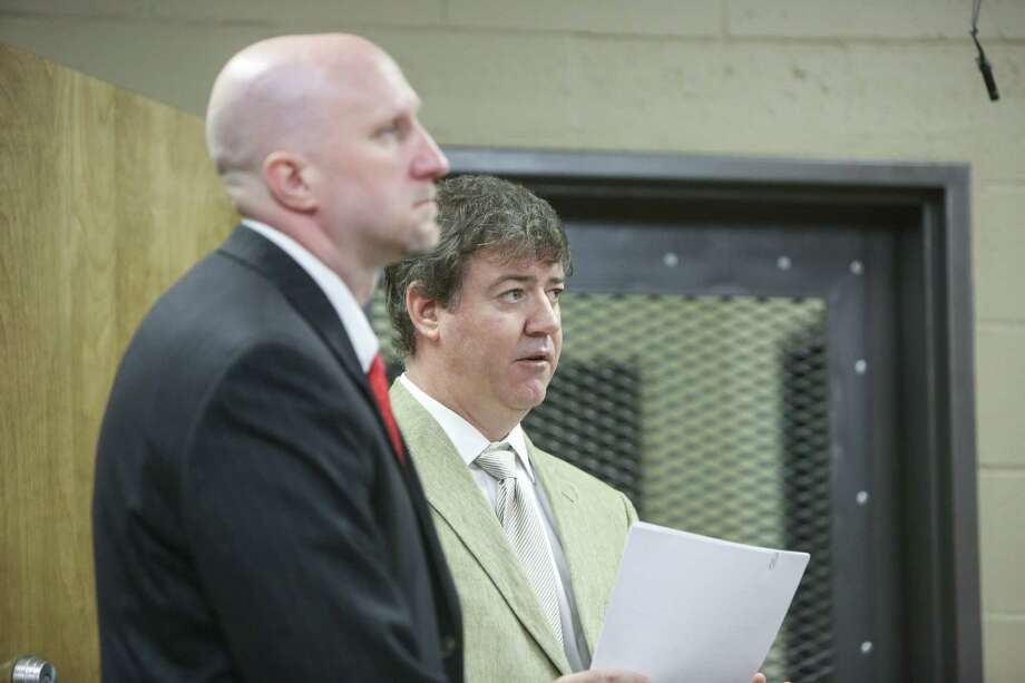 Attorneys Rob Madsen, left, and Boyd Young represent Thomas Ray Jones, Jr., at his arraignment in Lexington, S.C. on Friday, Sept. 12, 2014. Jones waived his right to appear at the hearing.  Jones is accused of killing his three boys and two girls, wrapping their bodies in separate trash bags and driving around for days with their decomposing bodies before dumping them on a rural hilltop in Alabama. Photo: (AP Photo/The State, Tracy Glantz)  / The State