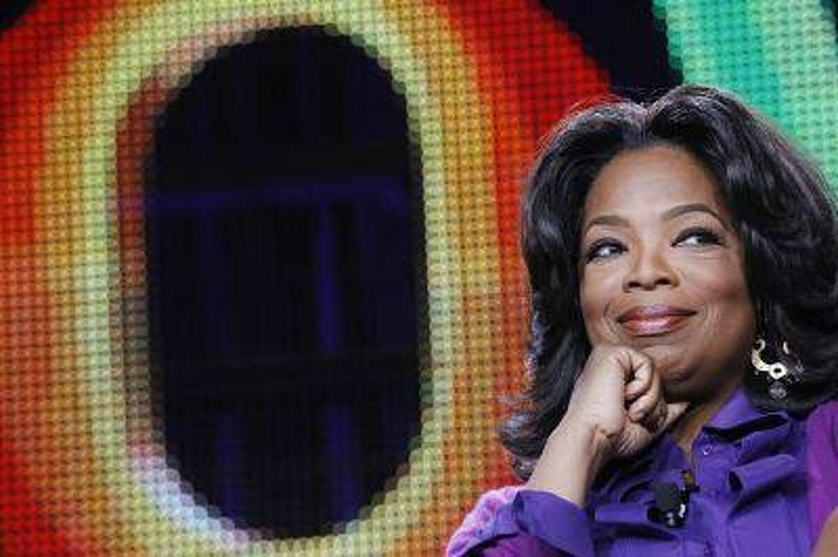 Oprah Winfrey attends a panel during the Oprah Winfrey Network (OWN) Television Critics Association winter press tour in Pasadena, Calif. in this January 6, 2011 file photo. REUTERS/Mario Anzuoni/Files