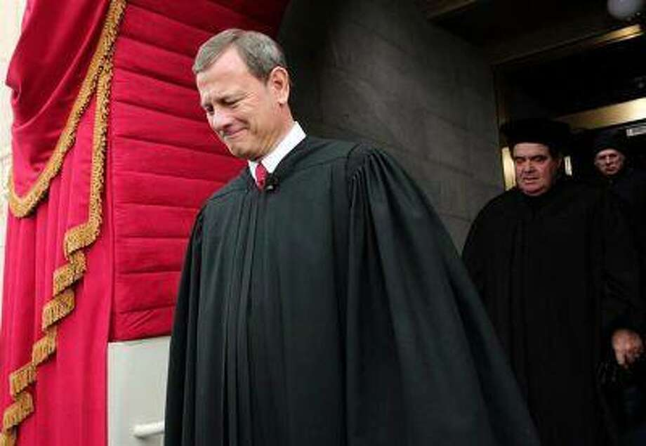Supreme Court Chief Justice John Roberts is followed by Supreme Court Justice Antonin Scalia as they arrive for the presidential inauguration on the West Front of the U.S. Capitol in Washington January 21, 2013. (Win McNamee/Reuters/Pool) Photo: REUTERS / X80003
