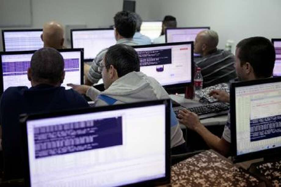 In this Tuesday Oct. 20, 2013 photo, Israelis work on computers at the 'CyberGym' school in the coastal city of Hadera. When Israel's military chief delivered a high-profile speech this month outlining the greatest threats his country will face in the future, he listed computer sabotage as a top concern, warning a sophisticated cyber attack could one day bring the nation to a standstill.