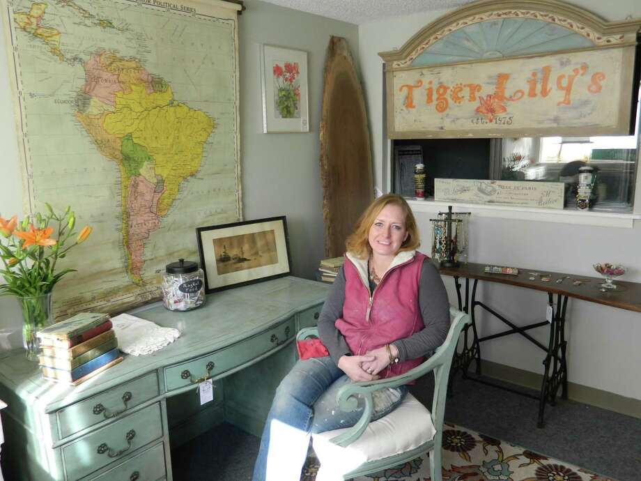 Photo by Jacqueline Bennett. Shawna Nelson in the front room of her new shop, Tiger Lily's furniture, near the Simsbury Airport.