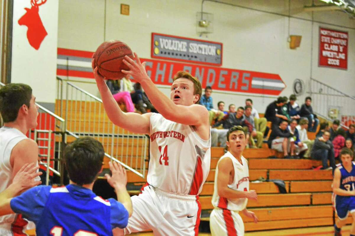 Northwestern's John Lippincott lays in two of his 11 points in the Highlanders 61-57 overtime win against Nonnewaug.