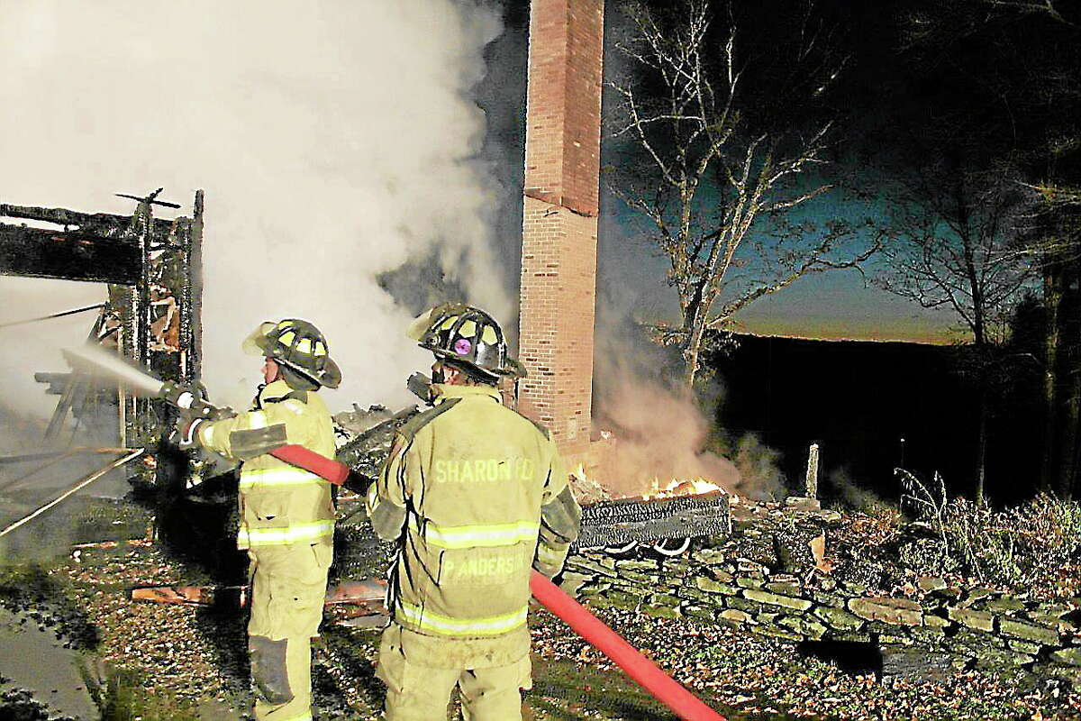 Firefighters work to extinguish an early morning fire that left one dead and destroyed a two-story home in Salisbury on Monday, Oct. 28.