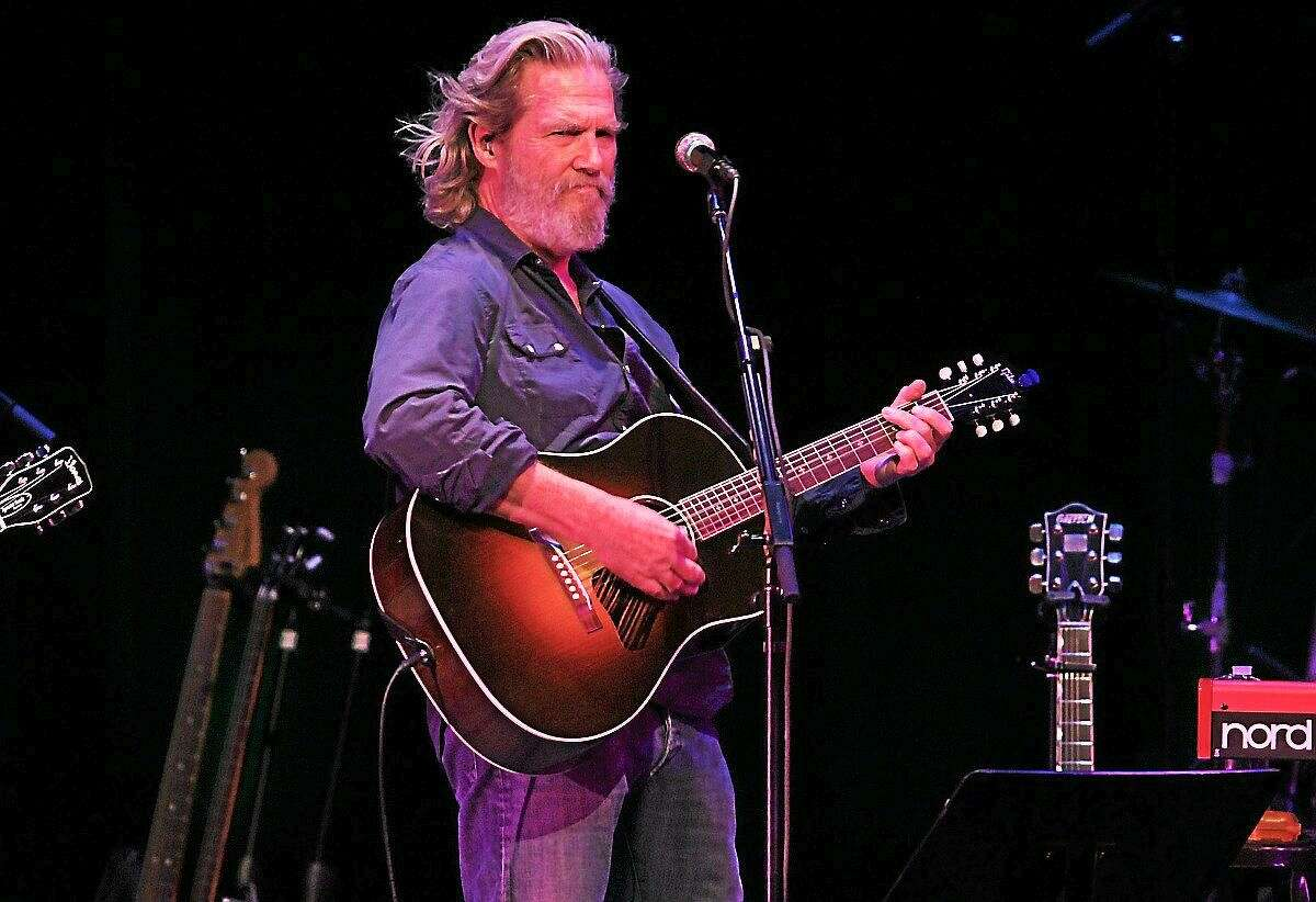 Photo by John Atashian Actor and musician Jeff Bridges is shown performing on stage during an appearance with the Abiders.