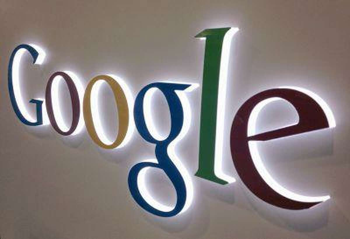 A Google sign is seen at a Best Buy electronics store in this photo illustration in Encinitas, Calif.