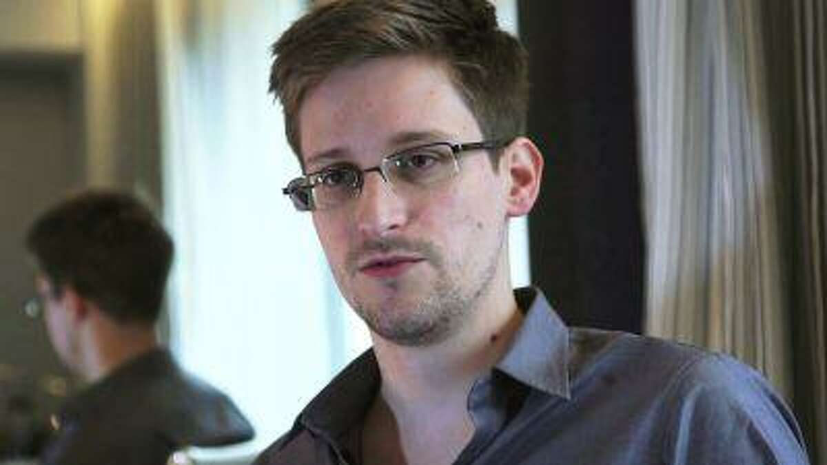 File photo of NSA whistleblower Edward Snowden being interviewed by The Guardian in his hotel room in Hong Kong.