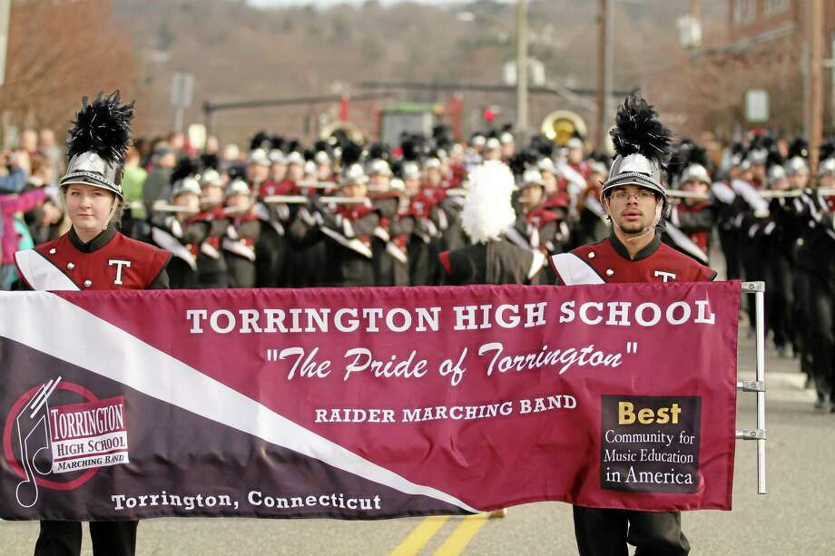 The Pride of Torrington, Torrington High School marching band, was a highlight of the Christmas Village parade and opening ceremonies on Sunday, Dec. 9. Photo: Contributed Photo — Marianne Killackey  / 2012