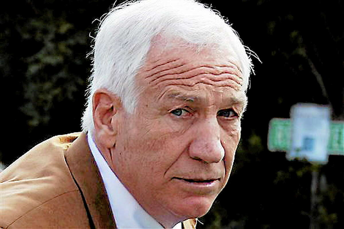 FILE - This June 22, 2012 file photo shows former Penn State assistant football coach Jerry Sandusky arriving at the Centre County Courthouse in Bellefonte, Pa. Sandusky should not get a new trial after being convicted of sexually abusing 10 boys, a Pennsylvania appeals court ruled Wednesday, Oct. 2, 2013. The decision by a three-judge Superior Court panel came barely two weeks after they heard oral arguments by Sandusky's lawyer and a state prosecutor. Sandusky, 69, is serving a 30- to 60-year prison sentence at a state prison in southwestern Pennsylvania. (AP Photo/Gene J. Puskar, File)