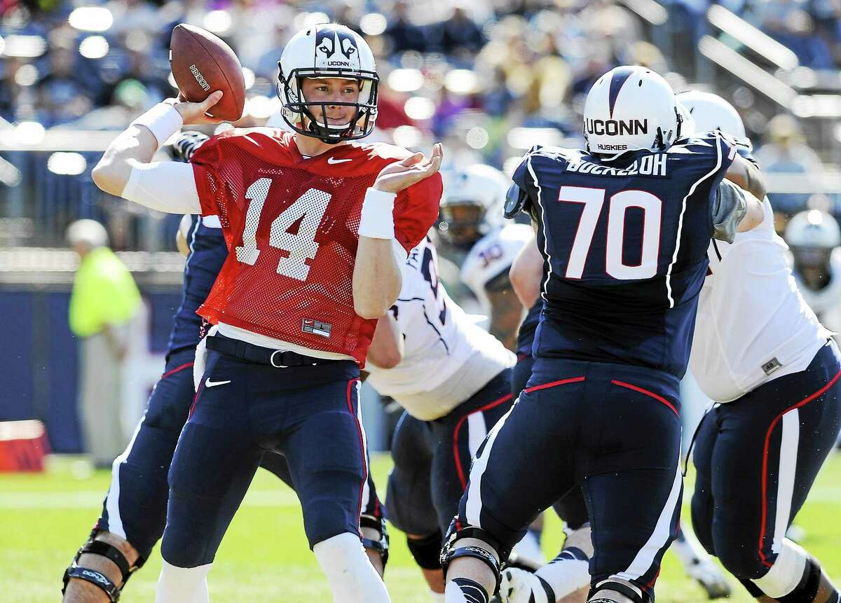 UConn quarterback Tim Boyle throws a pass during the Blue-White spring game in April at Rentschler Field in East Hartford.