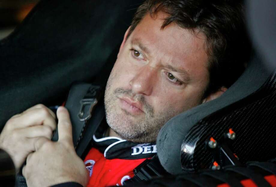 A grand jury will decide whether Tony Stewart will be charged in the August death of fellow driver Kevin Ward at a sprint car race in upstate New York, Ontario County District Attorney Michael Tantillo announced Tuesday. Photo: Glenn Smith — The Associated Press File Photo  / FR28473 AP