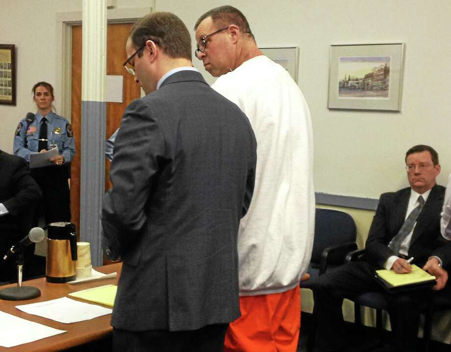 Former Finance Director Henry Centrella pleaded guilty to five counts of first-degree larceny for stealing more than $2 million from the Town of Winchester between 2008 and 2012. At right is Winchester Town Attorney Kevin Nelligan. Photo: Mercy Quaye—Register Citizen