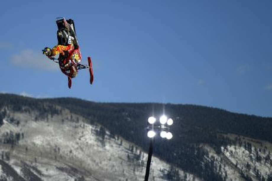 Colten Moore rides his sled during a snowmobile freestyle practice session Thursday Jan. 23, 2014, in Aspen, Colo. Moore's older brother, Caleb Moore, died last year as a result of an injury suffered in the snowmobile freestyle competition.