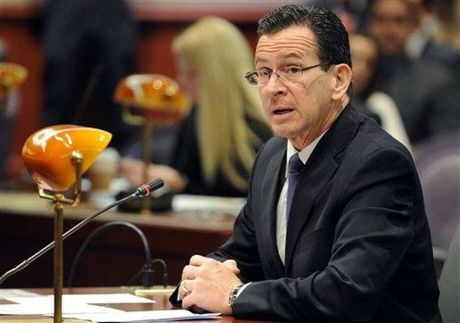 Connecticut Gov. Dannel Malloy addresses the Sandy Hook Advisory Commission at their first meeting Thursday, Jan. 24, 2013 at the Legislative Office Building in Hartford, Conn. (AP Photo/The Connecticut Post, Autumn Driscoll) MANDATORY CREDIT Photo: AP / The Connecticut Post