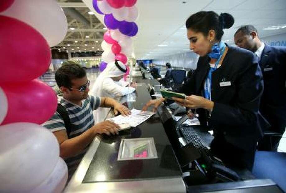 Passengers check-in at the newly opened Al Maktoum International Airport in Dubai, United Arab Emirates, Sunday, Oct. 27, 2013.