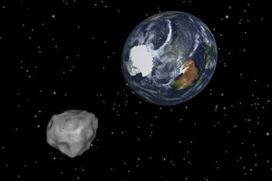 This image provided by NASA/JPL-Caltech shows a simulation of asteroid 2012 DA14 approaching from the south as it passes through the Earth-moon system on Friday, Feb. 15, 2013. The 150-foot object will pass within 17,000 miles of the Earth. NASA scientists insist there is absolutely no chance of a collision as it passes. (AP Photo/NASA/JPL-Caltech) Photo: AP / NASA/JPL-Caltech