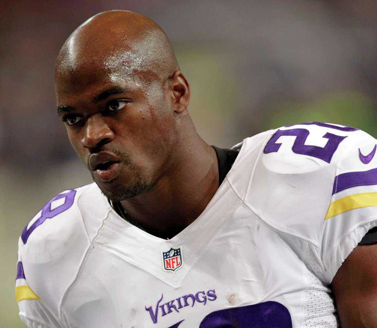 Minnesota Vikings running back Adrian Peterson warms up for a Sept. 7 game against the Rams in St. Louis.