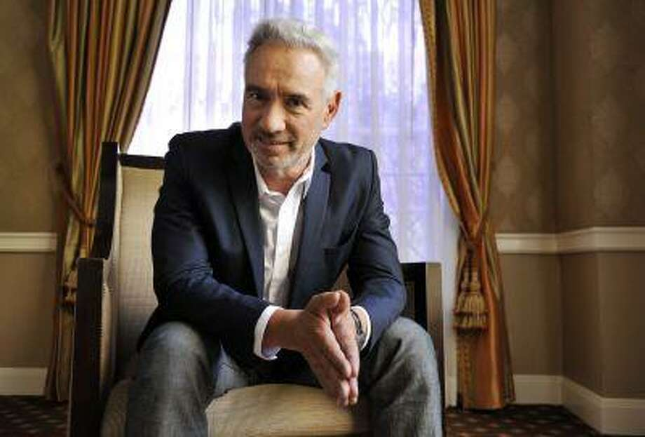 """In this Tuesday, June 18, 2013 photo, Roland Emmerich. director of the film """"White House Down,"""" poses for a portrait in Beverly Hills, Calif. The action-packed film starring Jamie Foxx as the President of the United States of America and Channing Tatum as his impromptu bodyguard releases Friday, June 28, 2013. (Photo by Chris Pizzello/Invision/AP) Photo: Chris Pizzello/Invision/AP / Invision"""