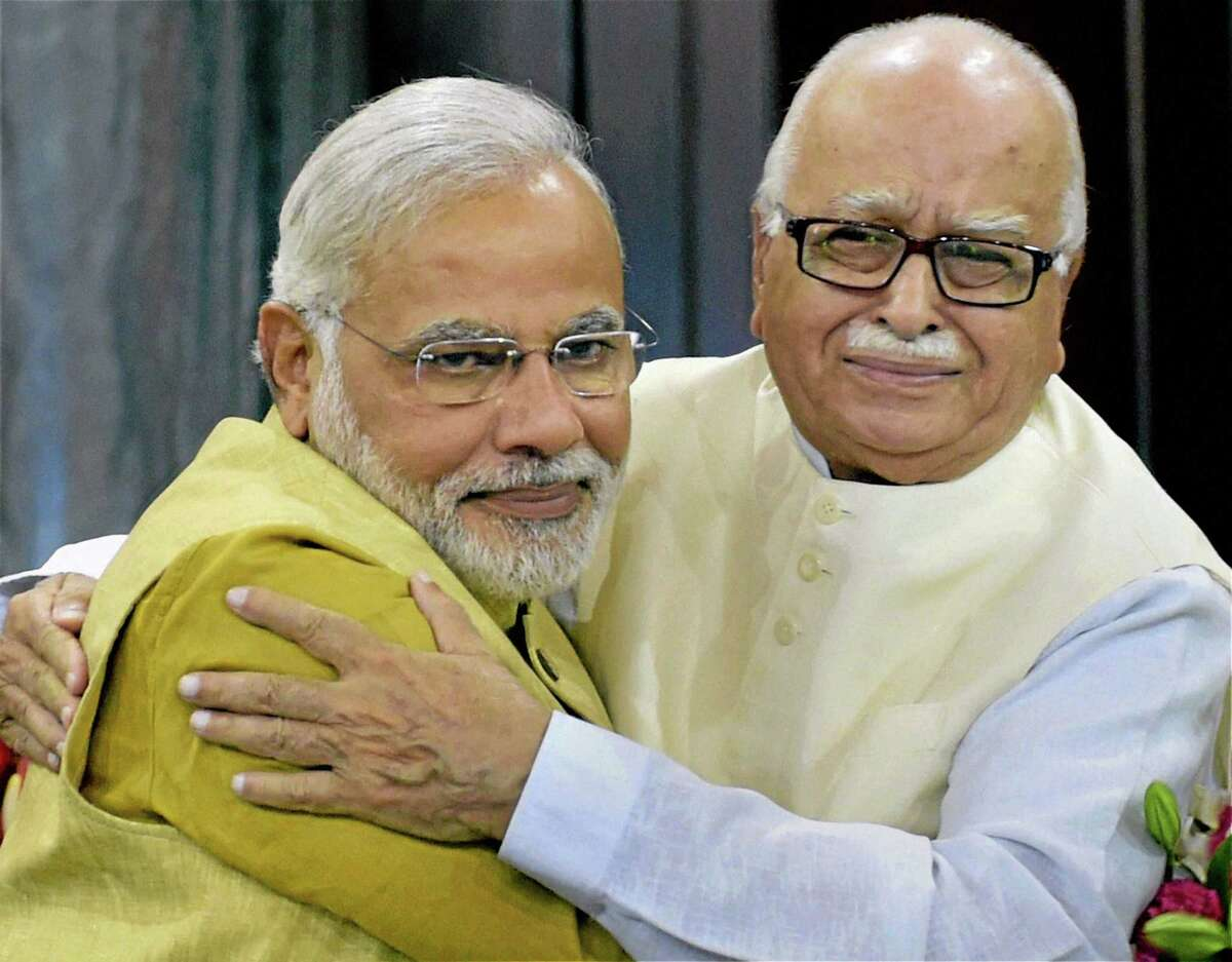 India's next prime minister and Hindu nationalist Bharatiya Janata Party (BJP) leader Narendra Modi, left, hugs party leader Lal Krishna Advani during the BJP parliamentary party meeting in New Delhi, India, Tuesday, May 20, 2014. Advani, the most senior party leader, nominated Modi for the prime minister's post, and the lawmakers gave their approval by thumping desks and raising slogans. (AP Photo)
