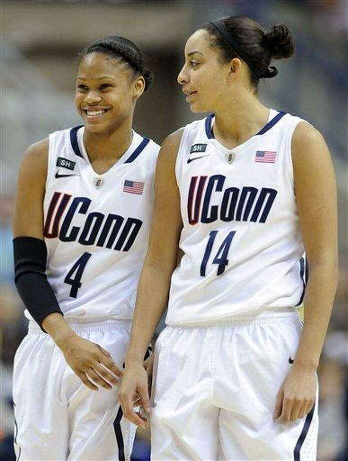 Connecticut's Moriah Jefferson, left, and Bria Hartley smile late in the second half of their team's 94-37 victory over Marquette in an NCAA college basketball game in Storrs, Conn., Tuesday, Feb. 5, 2013. (AP Photo/Fred Beckham) Photo: ASSOCIATED PRESS / AP2013
