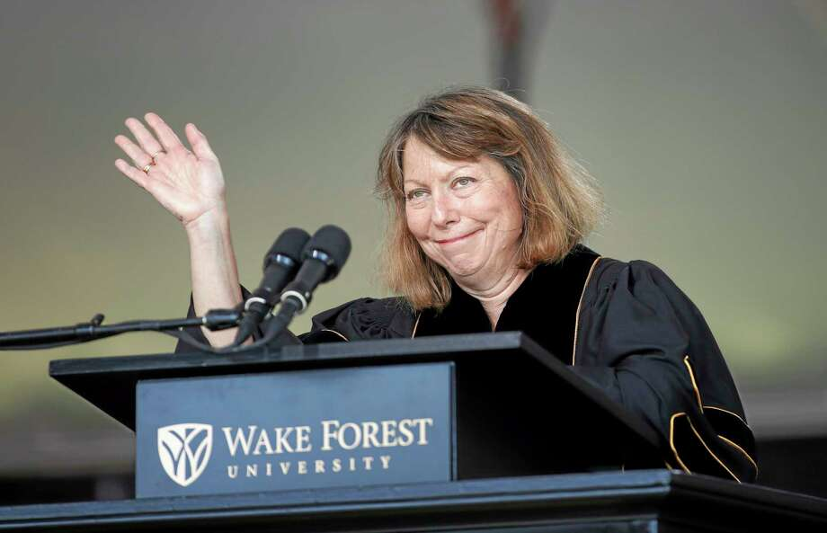 """Jill Abramson, former executive editor of The New York Times, waves as she speaks at the commencement ceremony at Wake Forest University in Winston-Salem,N.C., Monday, May 19, 2014. """"What's next for me? I don't know. So I'm in exactly the same boat as many of you,"""" Abramson told the Class of 2014 Monday morning. The Times announced last week that Abramson was being replaced by managing editor Dean Baquet. (AP Photo/Nell Redmond) Photo: AP / FR25171 AP"""