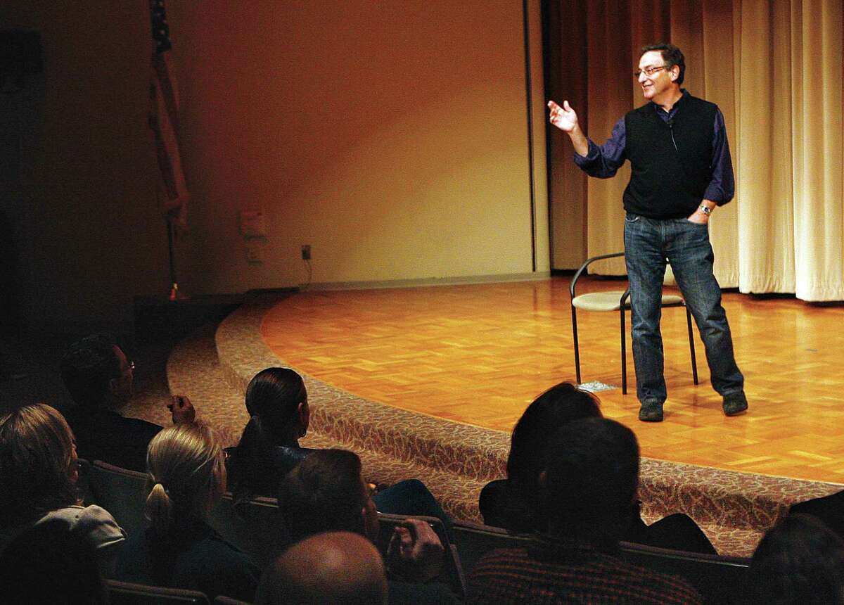 """FILE - In this Monday, Oct. 29, 2012, file photo, Ira Flatow, host of National Public Radio's Science Friday, speaks to a group of Pacific Northwest National Laboratory scientists and Delta High School students at Battelle Auditorium in Richland, Wash. Federal prosecutors say the National Public Radio show """"Science Friday"""" and host Flatow have settled civil claims that they misused money from a nearly $1 million federal grant aimed at boosting the show's reach to younger listeners. (AP Photo/The Tri-City Herald, Paul T. Erickson, File)"""