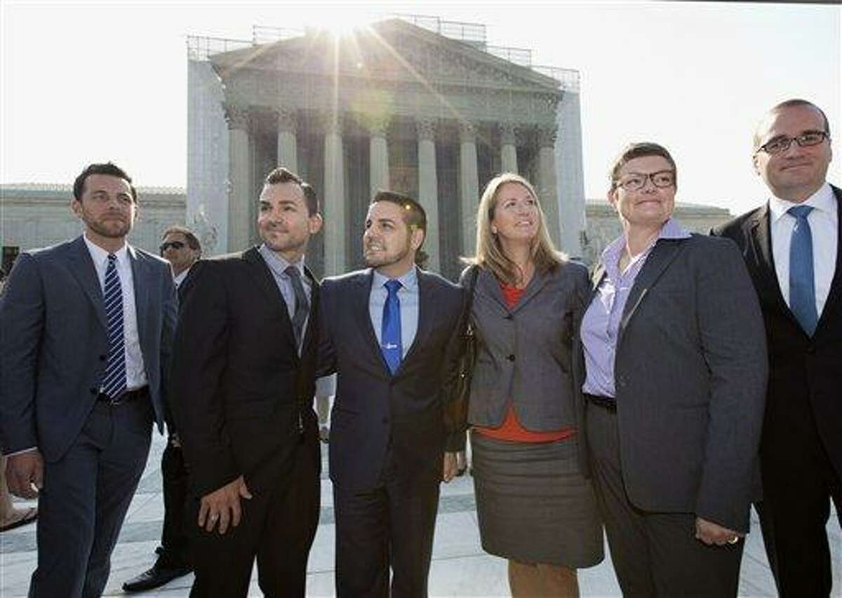 Arriving at the Supreme Court in Washington, Wednesday, June 26, 2013, on a final day for decisions in two gay marriage cases are plaintiffs in the California Proposition 8 case. From left are, Adam Umhoefer, executive director of the American Foundation for Equal Rights, plaintiffs Paul Katami, his partner Jeff Zarrillo, Sandy Stier and her partner Kris Perry, and Chad Griffin, president of the Human Rights Campaign. (AP Photo/J. Scott Applewhite)