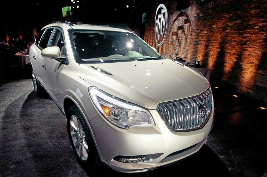 This April 3, 2012 file photo shows the 2013 Buick Enclave as it is unveiled at a news conference ahead of the New York International Car Show, in New York. General Motors on Tuesday, May 20, 2014 announced the recall of 2.4 million vehicles in the U.S., including the 2013 Enclave and other full-size crossovers from the 2009-2014 model years, as part of a broader effort to resolve outstanding safety issues more quickly. (AP Photo/Mary Altaffer, File) Photo: AP / AP