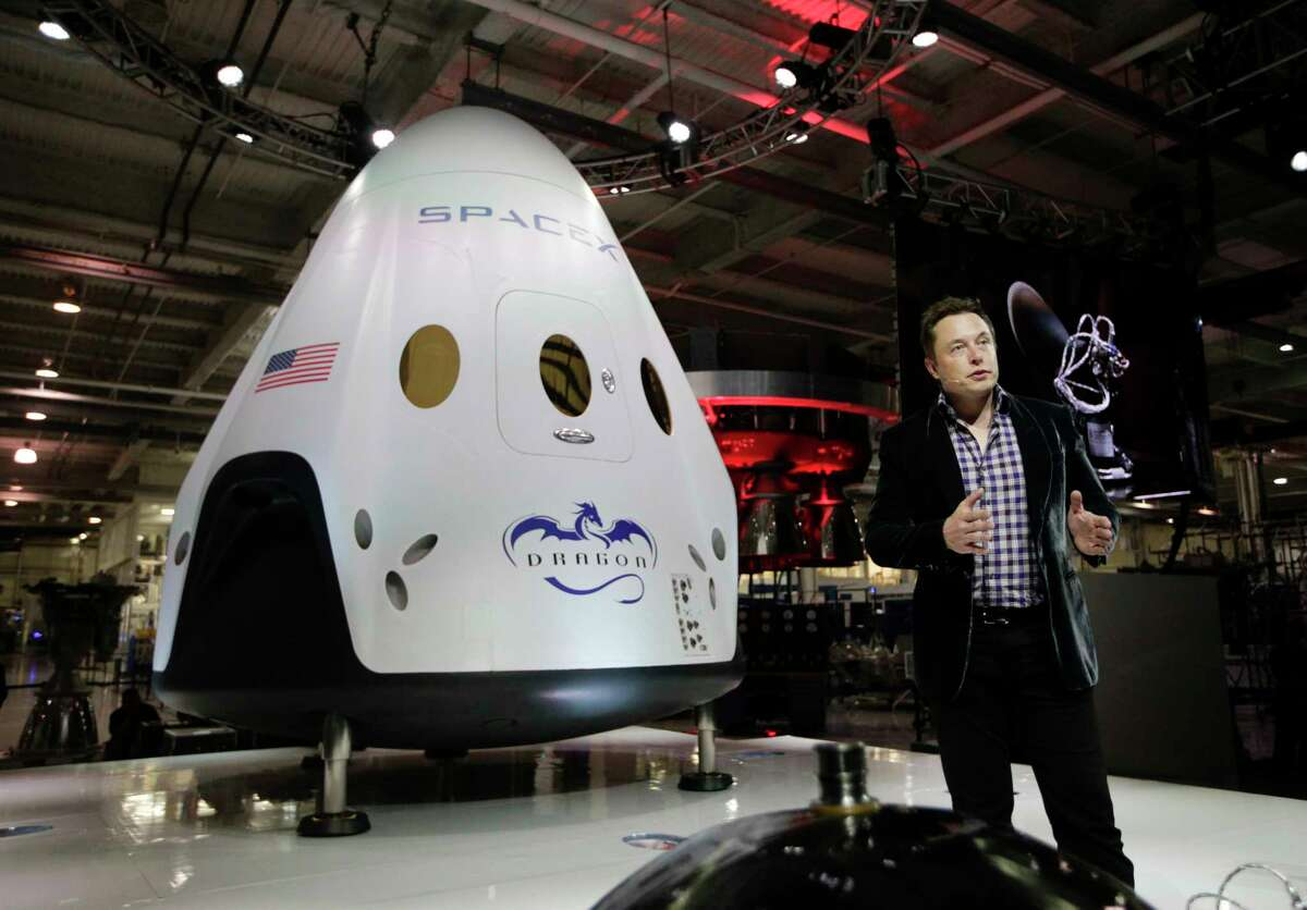 In this May 29, 2014 photo, Elon Musk, CEO and CTO of SpaceX, introduces the SpaceX Dragon V2 spaceship at the SpaceX headquarters in Hawthorne, Calif. On Tuesday, Sept. 16, 2014, (AP Photo/Jae C. Hong, file)