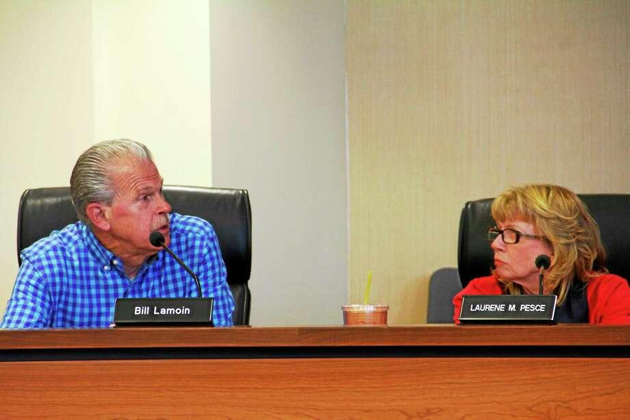 Laurene Pesce, right, listens to Bill Lamoin speak during the Board of Finance meeting on Tuesday, May 20, 2014, in Torrington. Esteban L. Hernandez Register Citizen Photo: Journal Register Co.