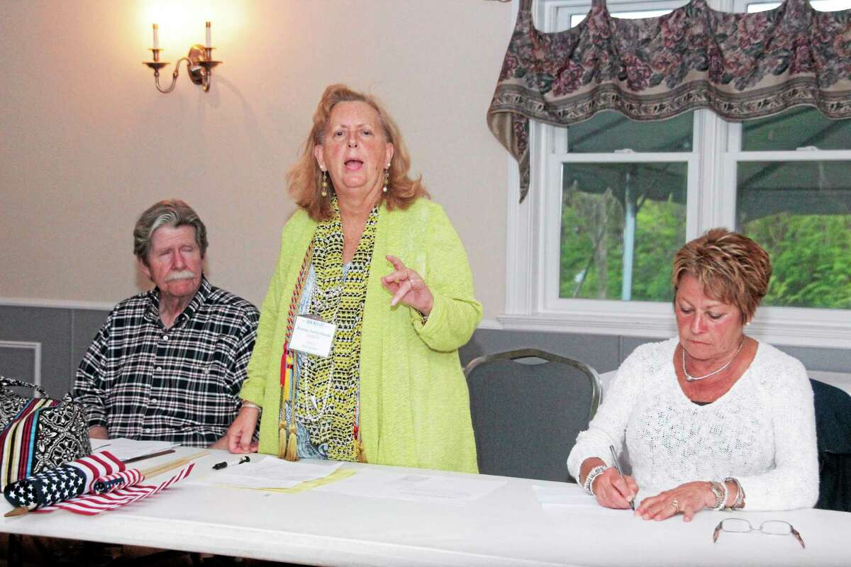 Audrey Blondin, center, speaks during the Democrats' 66th District Convention in Litchfield Tuesday.